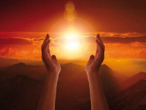 Mit den Händen Licht bringen